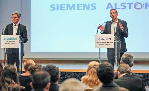 Joe Kaeser (izda.) y Henri Poupart-Lafarge (dcha.) durante la rueda de prensa en la que han anunciado la creación del grupo Siemens Alstom