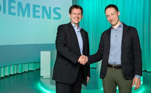 Eike-Oliver Steffen, Head Solution and Service Portfolio en Siemens Building Technologies (izda.) con Andrew Krioukov, CEO de Comfy
