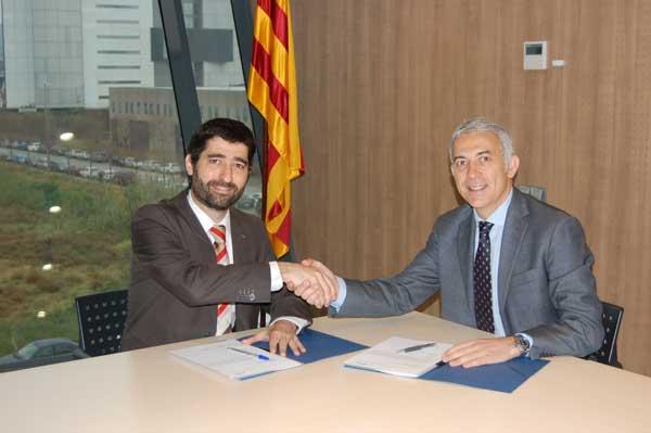 Jordi Puigneró y Ernest Quingles tras la firma del acuerdo
